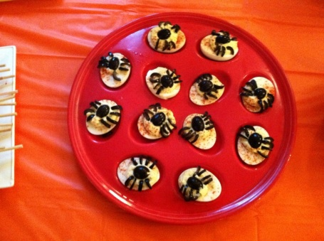 Slice olives to make your deviled eggs extra creepy!
