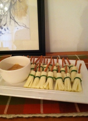 Slice mozzarella cheese and add a pretzel stick. I tied these up with chives and served with mustard.