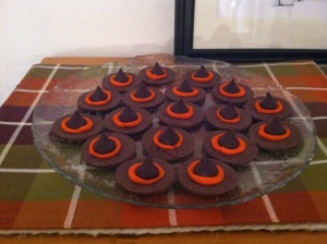 These are Fudge Stripe cookies turned upside down with a little orange icing and a dark Hershey's Kiss.