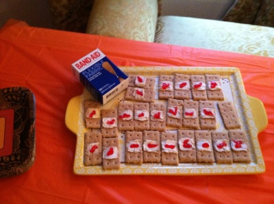 Graham cracker and cream cheese band-aids.