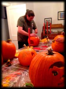 Husband meticulously carving his creation.